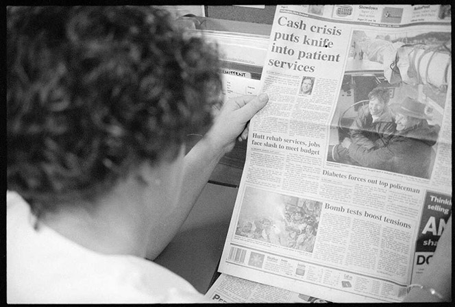 Person reading a newspaper.