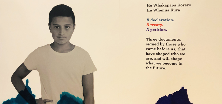 Image of boy alongside words about the He Tohu exhibition