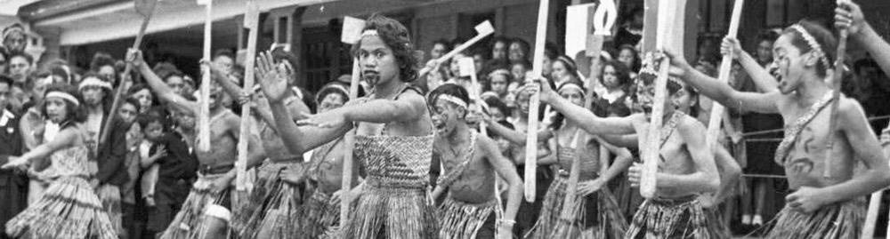 Māori boys and girls performing kapa haka.