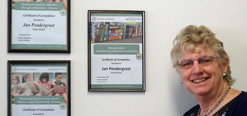School Librarian Jan Pendergrast with her certificates from her National Library online professional development courses