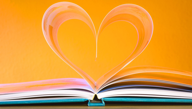 Open book with a heart graphic coming out from its centre.