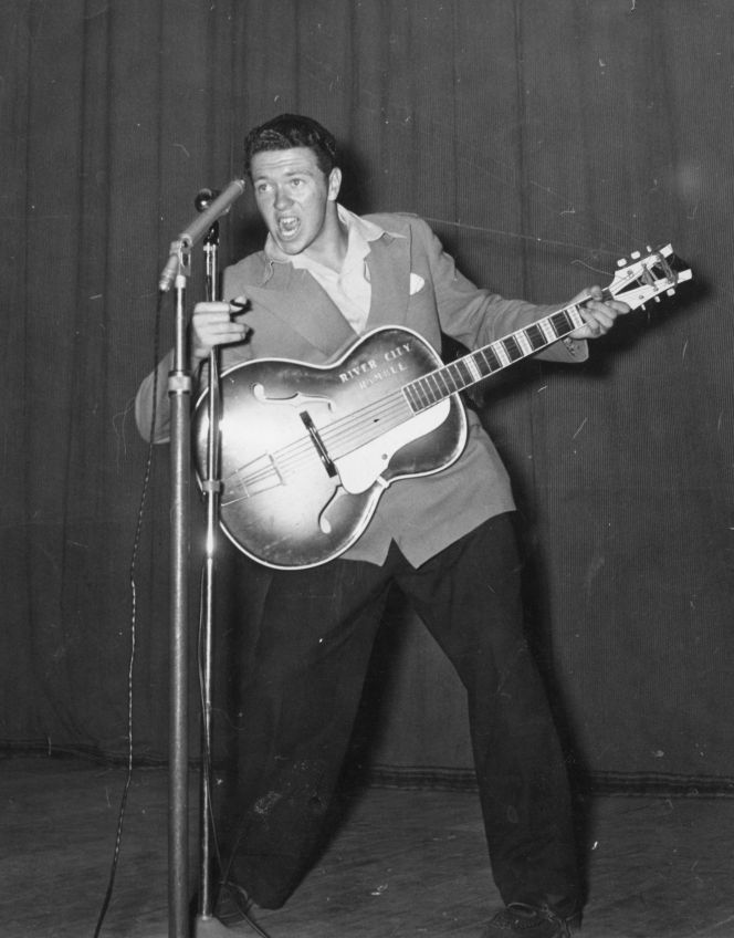 Johnny Devlin (Mr. Presley) singing.