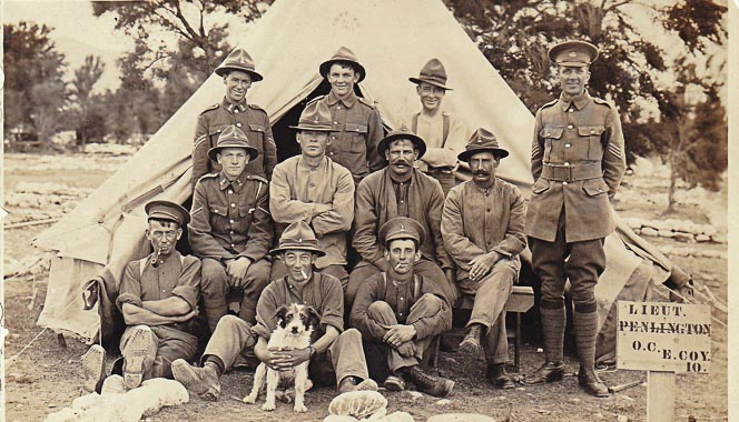 New Zealand WW1 soldiers and a dog in front of a tent.
