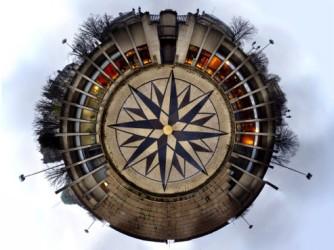 A strange circular view of a building, evocative of a compass.