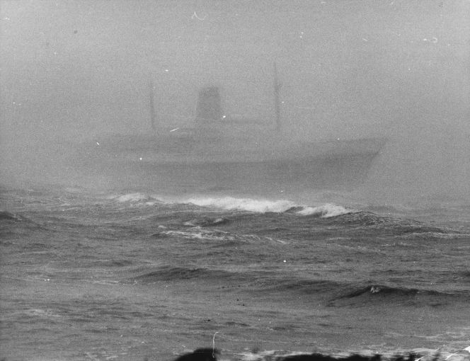 One of the few photographs of the Wahine upright taken from the shore.