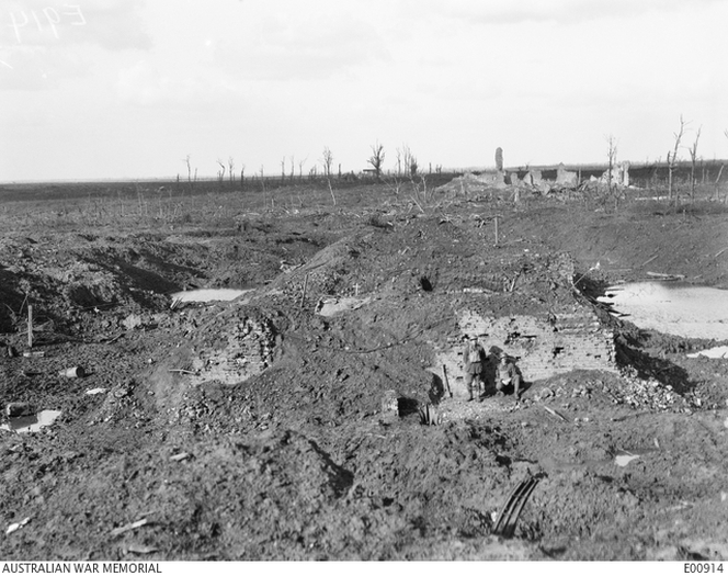 Looking over the brick kiln at Zonnebeke, in the Ypres Sector. Showing the ruins of Zonnebeke Church in the rear.