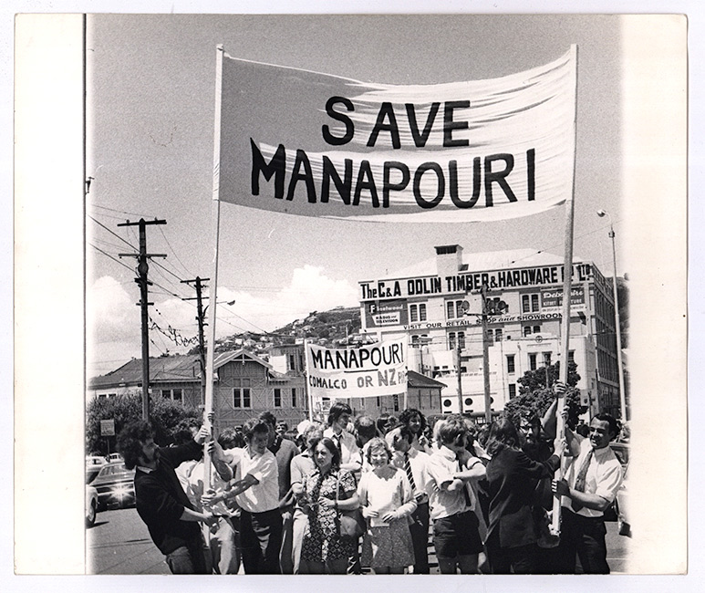A Wellington street protest, circa 1970. Protestors are holding large banners, 'Save Manapouri'.  [Save Manapouri](/files/schools/hm20-save-manapouri-english.mp3)