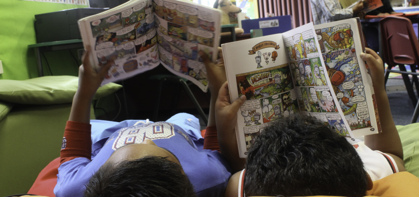 Boys reading graphic novels.
