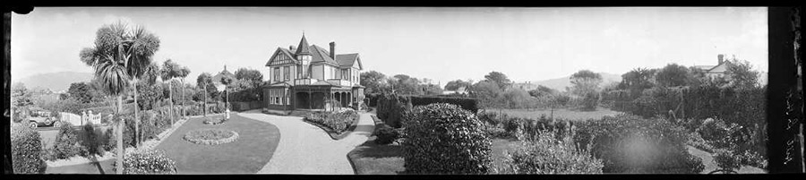 Panoramic photo of a house and garden.