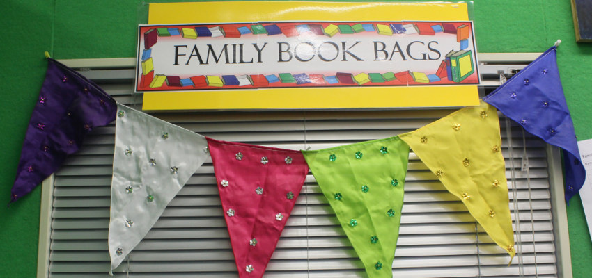 Bunting and sign saying 'family book bags'.