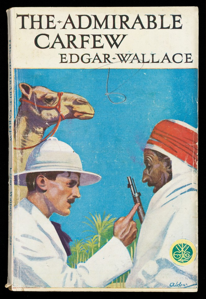 Cover of The Admirable Carfew, showing a fairly colonialist scene of a European man and a Middle Eastern man. A camel looks on.