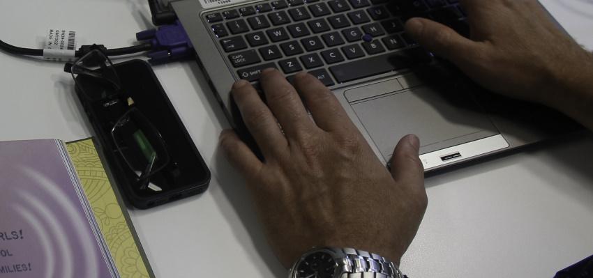 An individual using a laptop.