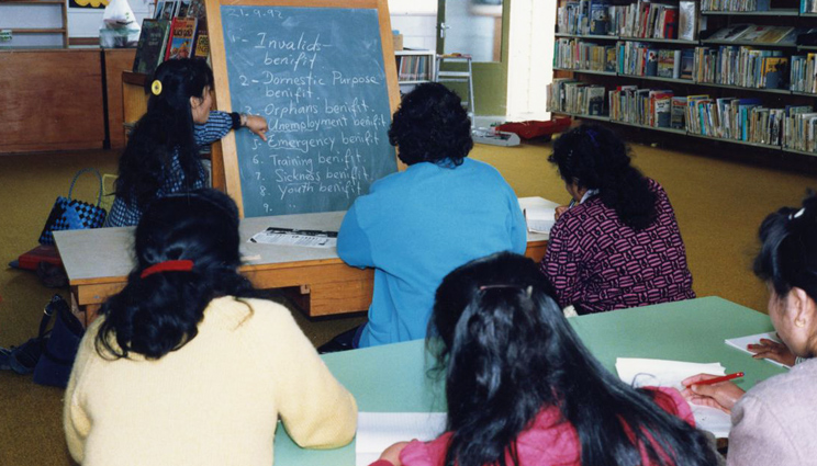 Cambodian refugees in the library learning about life in NZ