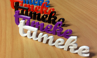 5 versions of the 3D printed word 'tūmeke' in white, purple, black, red and blue.