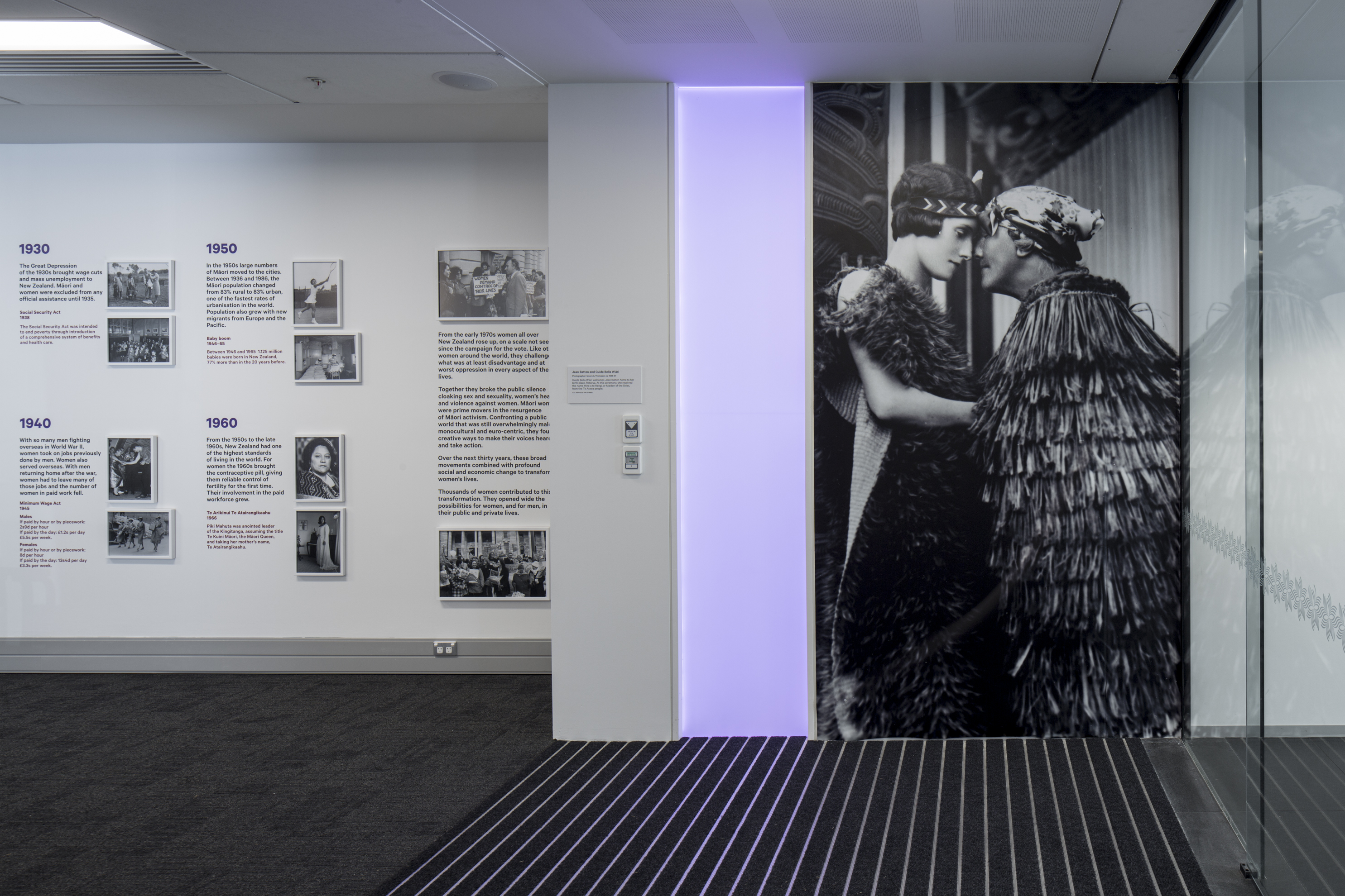 Photograph of an exhibition including a large photograph of Guide Bella greeting Jean Batten.