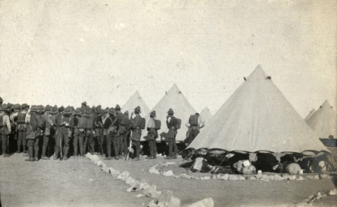 Soldiers gathering around to hear an announcement in the tent lines, Zeitoun Camp, 1915.