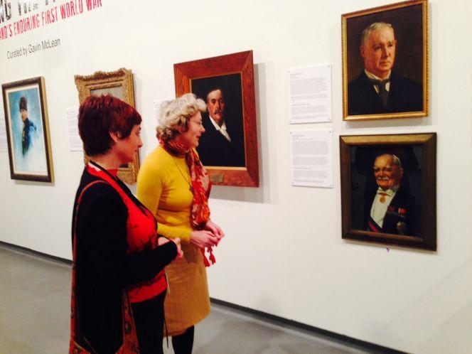Librarian, Corrina Gordon (left) with Portrait Gallery Director, Avenal McKinnon viewing the portrait of Sir James Allen.
