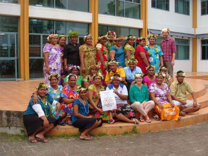 Workshop participants gathered together, wearing traditional headwear on International Archives Day.