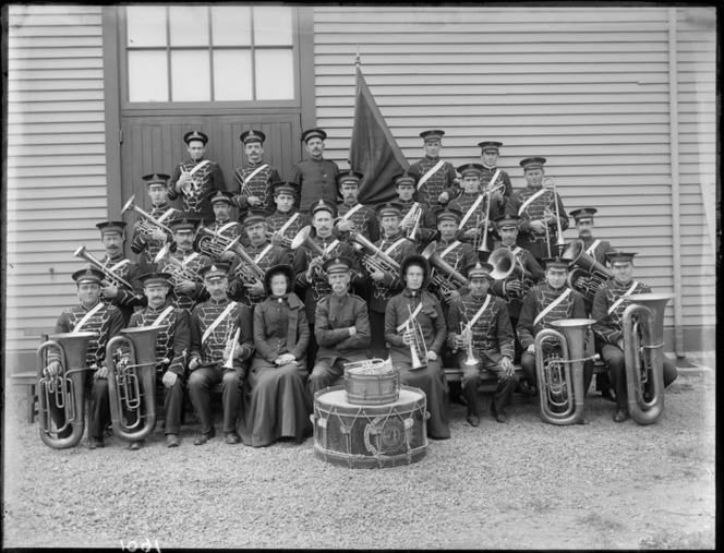 Group portrait of Salvation Army Brass Band, probably in the Christchurch region.