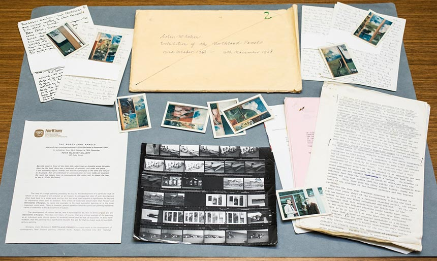 Contents of Exhibition File Number 2, pictures and letters displayed on a table