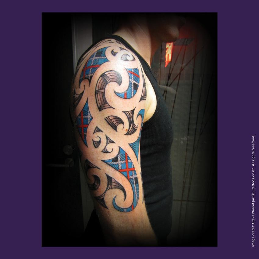 Front of curiosity card TMCC16 with an image of a tattoo on a person's arm that combines Māori kōwhaiwhai design with Scottish tartan patterns