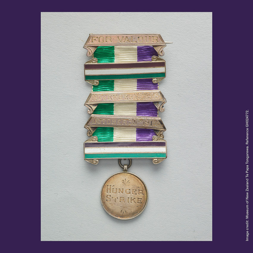 Front of curiosity card CC0014, with an image of a purple, white and green ribboned Medal For Valour awarded to Frances Parker. Medal reads 'HUNGER STRIKE'