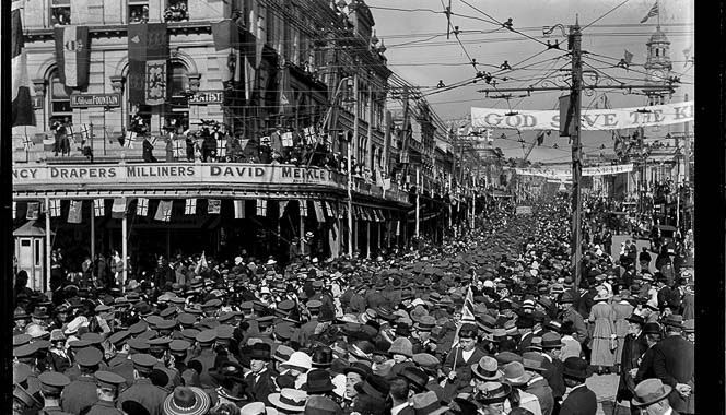 A packed crowd of soldiers and civilians celebrating armistice in Auckland.