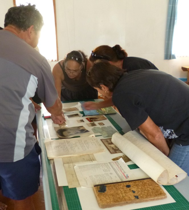 Andrew, Karen, Anne, and Dianne examining whānau items as part of the workshop.