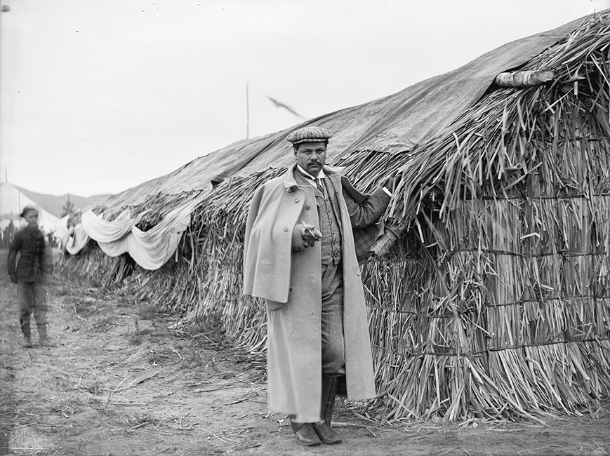 Māui Pōmare, the first Maori doctor of medicine, is standing next to a whare raupō, Rotorua 1901. He is dressed in a woollen suit, coat, cap and leather boots.  [Māui Wiremu Pōmare](/files/schools/hm98-maui-wiremu-pomare-english.mp3)