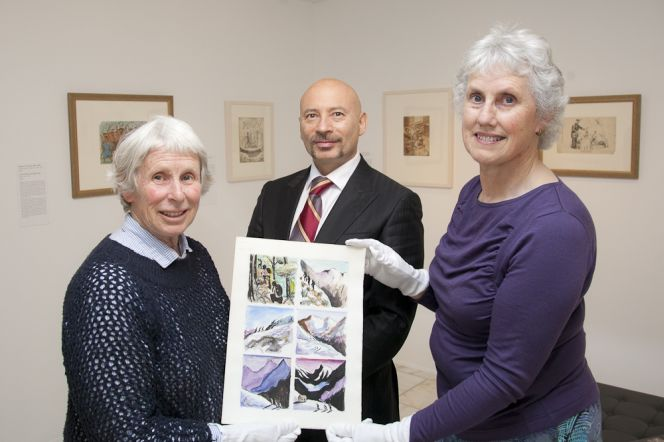 Tanya Ashken with a page from the album, along with Curator Marian Minson and Chief Librarian Chris Szekely.