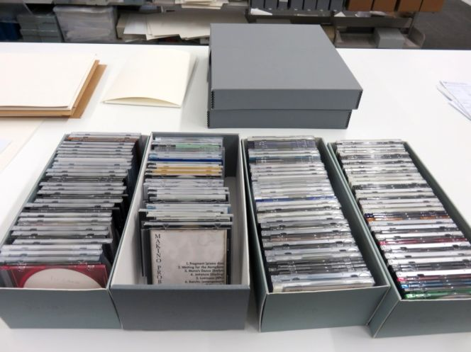 Optical discs separated into those containing audio files, video files, or computer files.