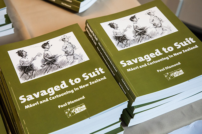 Copies of Savaged To Suit Book in a pile.