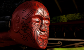 Carved figurehead on a war canoe at Waitangi, NZ