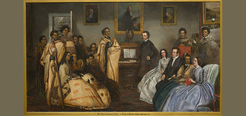 Painting by James Smetham showing a group of Māori in traditional dress meeting with a group of English people in formal dress in Wesley's house