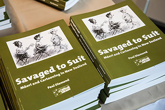 Two piles of the book 'Savaged to Suit' by Paul Diamond.
