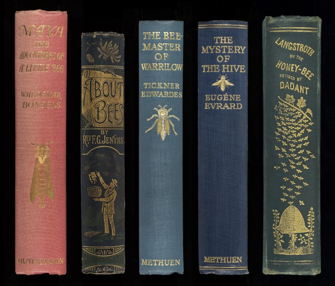 Spines from the Earp collection, showing the common bee motif.