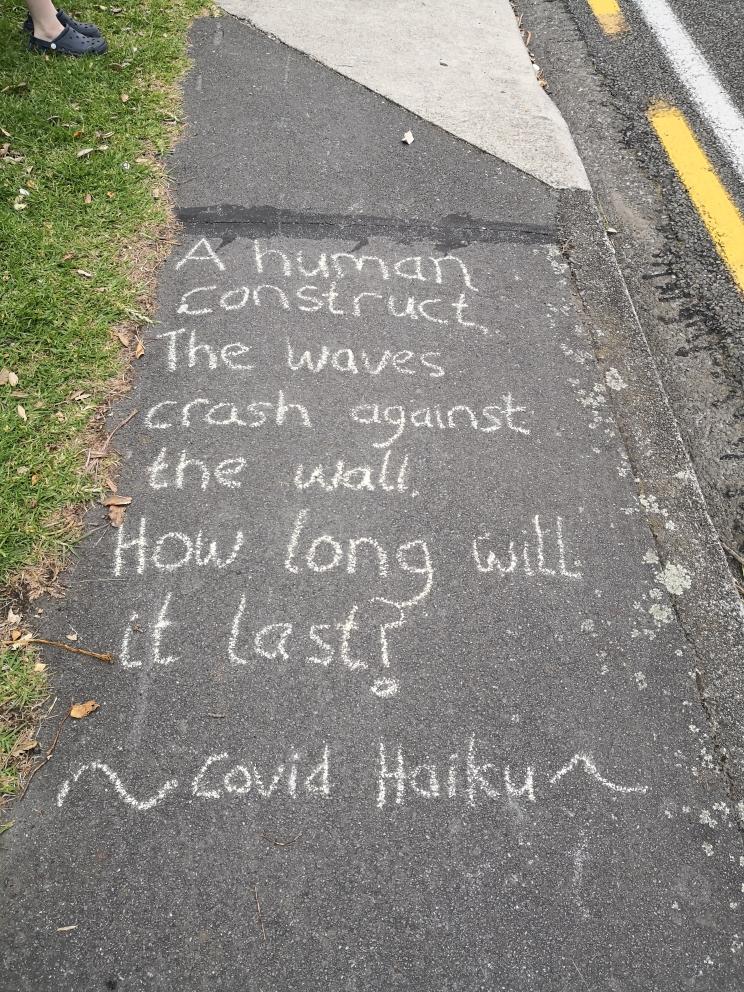 'Covid haiku' written in chalk on the footpath.