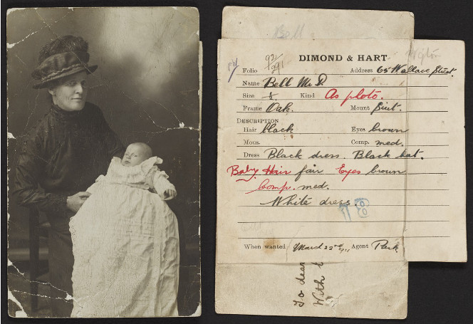 Silver gelatin print with instructions for hand-colouring adhered to the back of the photograph. Shows a woman holding a baby.