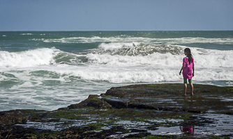 Young girl gazing out to sea.