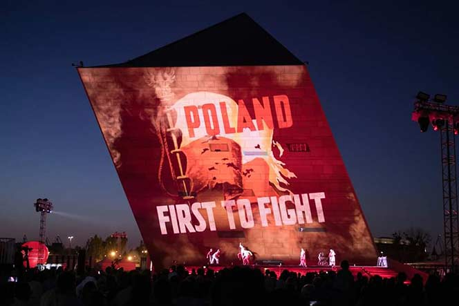 A sign saying first to fight on a large screen.
