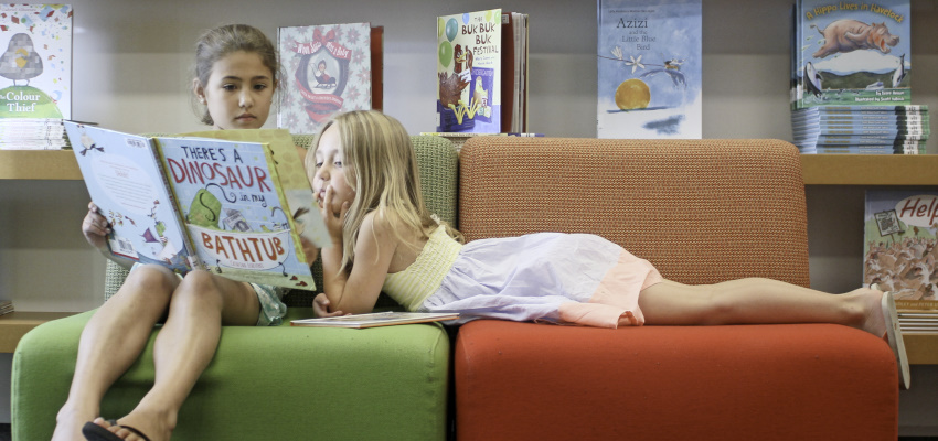 Girls reading picture books.