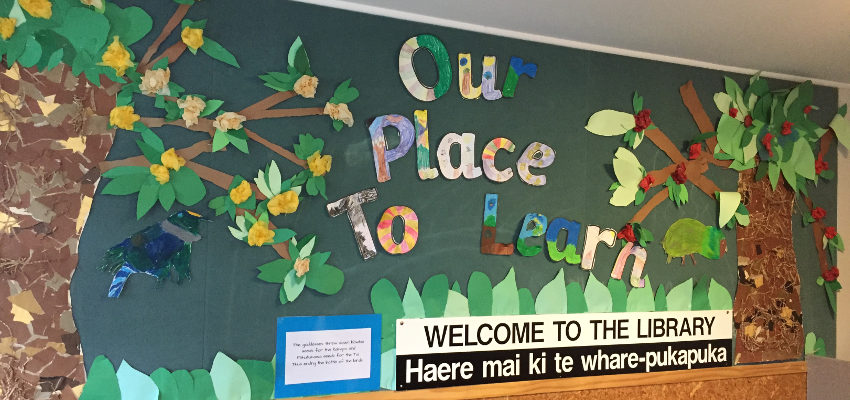 Sign with 'Our place to learn' and 'Welcome to the library'.