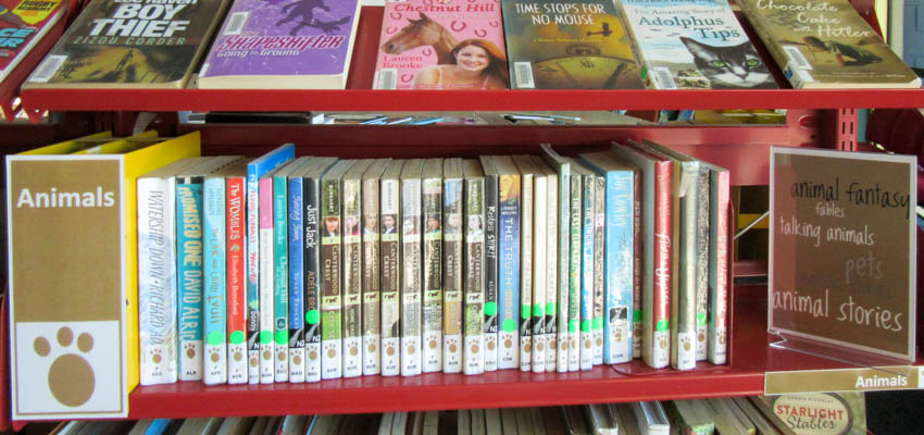 Arrange fiction by genre in the library.