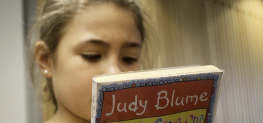 Student choosing a book.