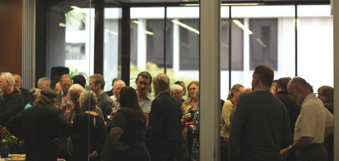 People inside of a room at the 'Good-bye Maoriland' book launch.