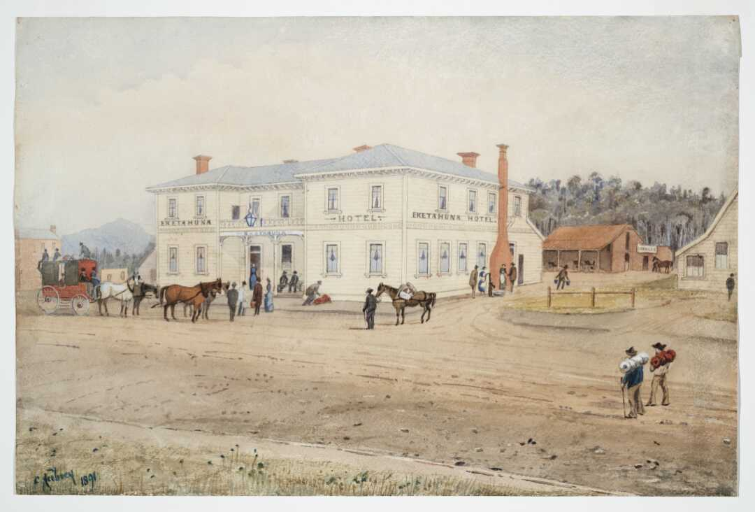 A coach drawn by four horses and people with luggage outside a wooden two-storey hotel building.
