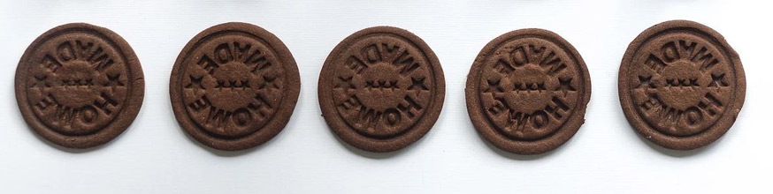 A row of chocolate biscuits with Home stamped on them.