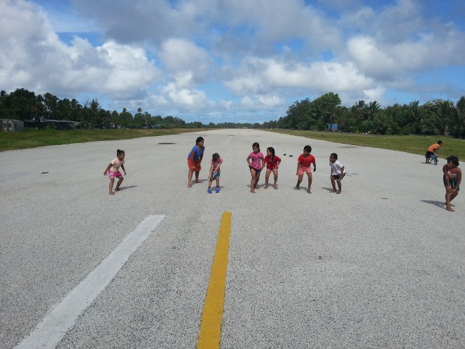 Children practicing their sprinting on the runway.