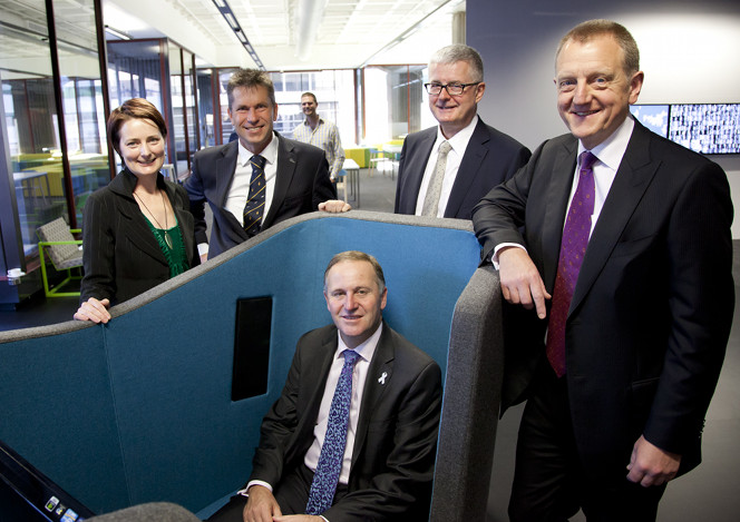 Prime Minister John Key sitting in an AV pod.