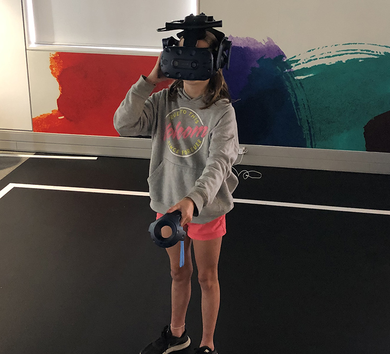 Student using the virtual reality device at He Tohu Tāmaki